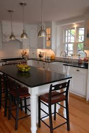 Custom Island Kitchen Sink And Stove Location With Island And Lamps Perfect
