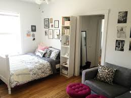 bed in the living room 5 genius ideas for how to layout furniture in a studio apartment