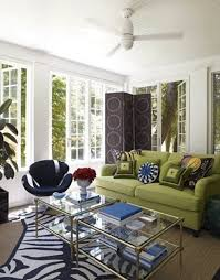 living room with glass coffee tables and a green sofa decorating