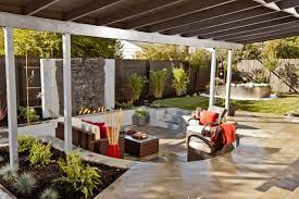 modern outdoor sunken living room design ideas with wood furniture