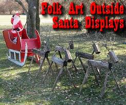 folk outside santa displays from family