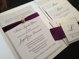 eggplant ribbon glamourous pocket wedding invitation in eggplant and gold shimmer