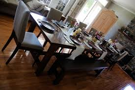 narrow varnished pine wood dining table combined long bench most