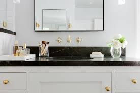 Gold Bathroom Mirror by Black And Gold Bathroom With Soapstone Countertops And Backsplash