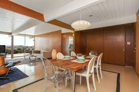 modern dining room with travertine tile floors u0026 pendant light in