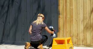 Spray Paint Bunnings - painting a timber fence brush or spray