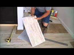 How To Lay Laminate Flooring Youtube - trafficmaster ceramica 12
