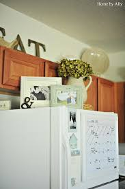 cute picture frames on top of fridge doing this for the home