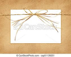 raffia bows beige raffia bow and a card on craft paper background stock