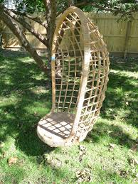fabulous design of swing for tree which is made of rattan and wood