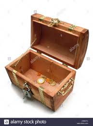 almost empty treasure chest with only a few coins stock photo