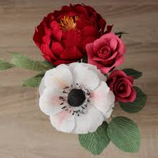 flower arrangement with anemone rose peony silver dollar