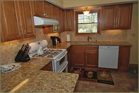 black marble countertops brown kitchen cabinets with black marble