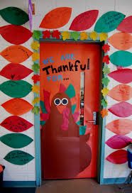 write on paper 594 best decorated doors images on pinterest classroom door 1st grade interactive thanksgiving door they write on paper feathers what they are thankful for