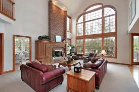 Great Room Family Lounge With Large Story Arched Window Brick - Great family rooms
