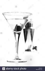 martini glass with olive black and white image of martini glass with olives and cocktail