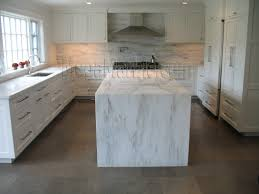 countertops white paneled cabinets white marble countertop black