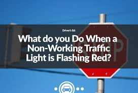 nonworking what do you do when a non working traffic light is flashing red
