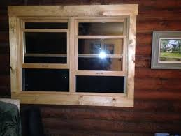 need help with window trim colors on log home