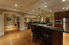 cool basement ideas as bar and play room with stone bar counter