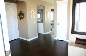 grey hardwood floors and double sided fireplace inside bedroom