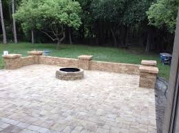 installing patio pavers paver patio area with fire pit and sitting wall nanopave 2 in 1