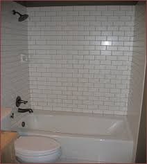 bathroom surround tile ideas white tile bathtub surround light gray grout lbn