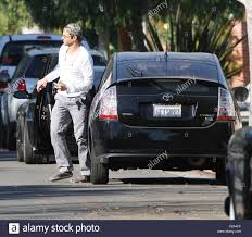 toyota home bradley cooper arrives back home in his toyota prius car wearing