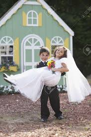 wedding dress up boy and girl at pretend wedding stock photo picture and royalty