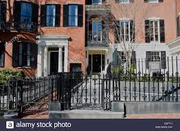 historic brick homes behind iron fences in the beacon hill stock