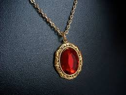 red gem necklace images Renaissance necklace with red gem in gold gold medallion jpg