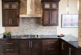 Dark Stain Kitchen Cabinets Dark Stained Cabinetry With Glass And Stone Mosaic Backsplash And