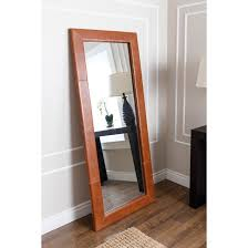 furniture pewter edted leaner mirror with wooden floor and rug