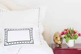 cream headboard with red lacquer nightstand contemporary bedroom