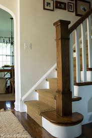 wood stairs with white risers and carpet runner vintage looking