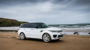 green range rover range rover sport phev wades into the sea races pro swimmers
