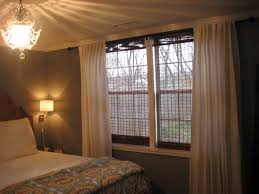 decorating bamboo roman shades with crown molding and white