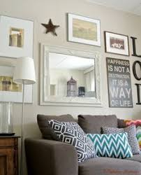 wall gallery ideas ground a wall gallery with a centerpiece such as a large wall