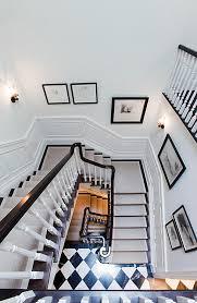floors on steps with a light runner black and white floor