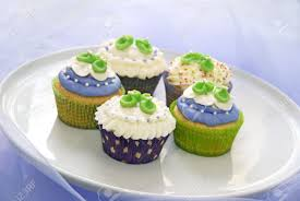 baby shower cupcakes in purple and green stock photo picture and