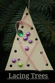 Preschool Holiday Crafts - lacing tree ornaments for toddlers happy hooligans
