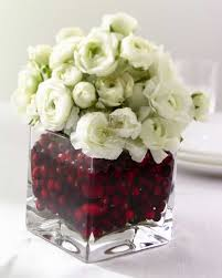 decorations white roses and red berries on contemporary glass
