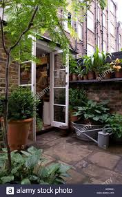Potted Patio Trees by Open Door To Garden Patio With Potted Plants Of Early 19th Century