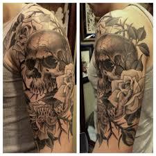 black rose and skull tattoo design idea for men and women