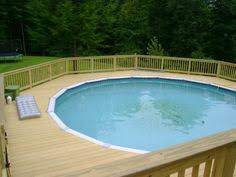 spacious deck with pool at one end above ground pool decks