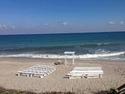 jupiter civic center beach ceremony set up intimate bench seating