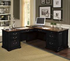 small home office spaces with brown antique desk with drawer and