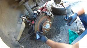 how to push brake caliper pistons back how to change brake pads