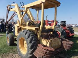 ford 550 tractor loader loaded down with rear counterweights