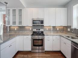 Kitchen Grey Modern White Kitchen With Grey Stone Work Top Stock Photo Picture